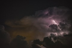 Lightning strikes behind a cloud as seen from an airplane window (Dave DiCello) Tags: sky night plane airplane lightning nikond600 lightningfromairplane davedicello