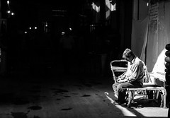 Esfahan Bazar (daniel.frauchiger) Tags: poverty street man lumix bed alone sitting sad iran market seat poor persia olympus panasonic lonely esfahan 45mm bazar gf1
