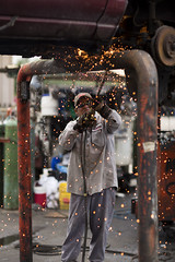 (Dylan Johnston) Tags: car yard fire cut clean torch melt junkyard recycle wreck sparks salvage destroy