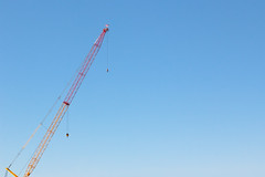 (EYECCD) Tags: blue sky construction crane americanflag clear minimalist flickrstock 550d