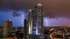 Blue to purple strikes (lostINmia) Tags: city two urban storm art night skyscraper 35mm nikon downtown view skyscrapers cloudy miami f14 infinity 14 broadway sigma nighttime condo lightning dual condos scape strikes d600 2013