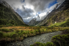 monkey creek revisited | fiordland, new zealand (elmofoto) Tags: travel newzealand sky nature water clouds creek landscape travels nikon exposure day mask fav50 cloudy dramatic fav20 explore valley southisland fjord milfordsound fav30 aotearoa fiord hdr southland masking 500v gettyimages luminance d800 blending luminosity fiordlandnationalpark 1000v fav10 fav100 fav200 10000v explored fav40 5000v fav60 2500v fav90 fav80 fav70 monkeycreek 1424mm nikond800 elmofoto lorenzomontezemolo tidder