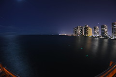 Miami (Rrjeffrey) Tags: ocean city longexposure blue sky tower beach wet water night skyscraper dark hotel evening pier us fishing nikon october warm purple florida miami united horizon towers calm fisheye nighttime states hotels ghosting ruleofthirds d3200
