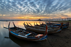Fishing Boats at U Bein Bridge, Mandalay. (Noom HH) Tags: life travel bridge sky lake water beautiful clouds sunrise asian boat fishing fisherman asia burma myanmar fishingboats woodenbridge mandalay amarapura ubeinbridge taungthaman 2013 unseenasia ubeng