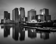 Silent City (vulture labs) Tags: city uk longexposure light england sky urban blackandwhite bw black building london art water monochrome lines skyline architecture modern contrast skyscraper buildings reflections photography mono mirror boat photo nikon europe long exposure cityscape shadows skysc