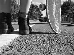 One Foot Out Of Line (e.mmacook) Tags: road bw white black feet wheel shoes legs line converse skateboard ribbon gravel tar centerline