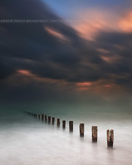 Stormy Sunset on Wood Pillars at Saint-Malo ( Ille-et-Vilaine - France ) (Yannick Lefevre) Tags: ocean longexposure sunset seascape storm france photoshop landscape nikon brittany raw nef tripod bretagne filter paysage dri cloudscape saintmalo manfrotto hoya ndfilter nd400 illeetvilaine poselongue skymotion ileetvilaine nikoncapturenx d700 ndx400 woodpillars capturenx2 yllogo nikkor1635mmf4 yannicklefevre||photography