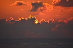 Peek a boo (Jason Fairbairn Photography) Tags: ocean sunset orange cloud beach water sunshine clouds waves waikiki dusk hiding waikikibeach waikikisunset