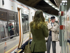 Stern Capped (Magic Pea) Tags: street woman man london train underground photography photo looking candid platform streetphotography streetphoto stern wapping magicpea
