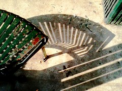Austin bus bench (Jen's Photography) Tags: shadow abstract black green metal contrast austin bench outside outdoors interestingness beige texas stripes seat grunge gray shapes explore capitol angels austintexas shade april noise eastaustin atx cellphone