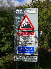 Wrynose and Hardknott Passes, Cumbria (Oxfordshire Churches) Tags: wrynosepass hardknottpass littlelangdale cumbria thelakedistrict englishlakes panasonic lumixgx1 mft microfourthirds micro43 england uk unitedkingdom ©johnward signs