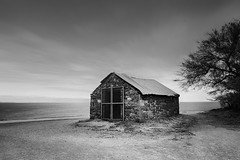 Custodian (Lindi m) Tags: longexposure outbuilding shed teignmouth coastal architecture building tree stone