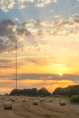 Cowbridge hay bales (technodean2000) Tags: cowbridge south wales uk nikon d5200 lightroom hay bales sunset sun sky radio mast outdoor landscape field d610