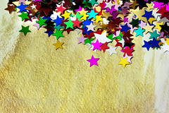 Colorful stars on gold background (PicciaNeri) Tags: glow festivities glitter starshape xmas christmas starnight seasonal festive celebration text birthday aspirations goldstar background black decorative card celebrate sparkle confettistars motif december present goldenconfetti goldconfetti winter gift border color party goldstars gold confetti star dreams goldenstars greetings holidaycard blue colorful holiday blank message ornate metallic decoration closeup goldenstar nobody copyspace happy golden