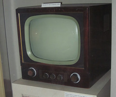Television (South Dakota State Historical Society) Tags: 2001 news west history hat television museum southdakota children poster stars town tv uniform paint gallery dish audience time drawing satellite worldtradecenter towers 911 saturday twin east reception changing national 1900 collapse western historical shows network september11 patriot rabbitears society changes eastern dakota homegrown channel kota rapidcity challenges siouxfalls afterschool coloredpencil missouririver 1900s converter entertain popularculture weekday ledger twentieth kelo spiraling announcers dakotaterritory changingtimes 20century jimyellowhawk dakotan 1900s captain11 southdakotans thatmorning dwaynewilcox