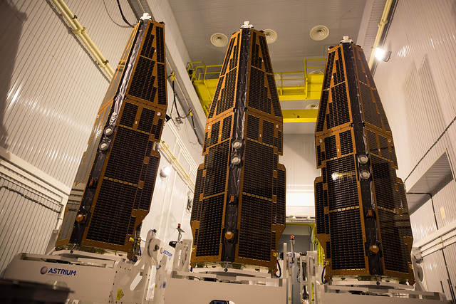 Three Swarm satellites in a row waiting to join the launch adapter