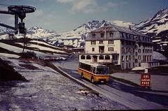 CH- SWITZERLAND 1983 (streamer020nl) Tags: 2005 schnee summer snow bus hotel schweiz switzerland sneeuw pass slide scan 1983 helvetia pas bellevue ch ptt zwitserland postbus 2005m coldusimplon vision:mountain=0518 vision:sunset=0544 vision:clouds=0528 vision:car=0526 vision:sky=0598 vision:outdoor