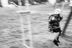 Go! (Cinzia Toscano) Tags: bw white black monochrome childhood blackwhite child fear swing surprise moved panning