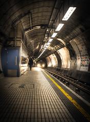 Approach (Stephen Champness) Tags: city london train underground subway lights fuji processed hdr undergroundstation photomatix lightroom4 fujix100 adobelightroom4 vision:sunset=0575 vision:clouds=0734 vision:sky=0813 vision:dark=0633