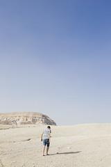 (romanraetzke) Tags: vacation sky sun man male boyfriend colors digital israel model sand nikon warm colours desert himmel sunny steine barefoot mann florian sonnig sonne wste farben judeandesert scherbe wst gerll laufend gehend judischewste barfus wandernd vision:sunset=0612 vision:outdoor=099 vision:clouds=0954 vision:sky=0989