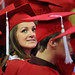 A grad looks back over her shoulder and smiles at family during spring 2014 commencement.