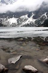 Morskie Oko, Tatry (Bartek Krawczyk) Tags: trip lake snow mountains ice canon frozen is spring rocks hiking stones may ii 1855 tatry oko morskie 60d