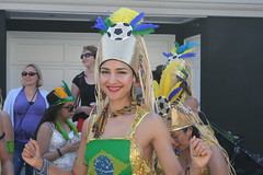 Smiling Woman at SF Carnaval (shaire productions) Tags: sf sanfrancisco street costumes summer brazil people urban woman colors girl beauty festival lady female women image outdoor candid flag picture streetphotography parade event photograph carnaval brazilian annual fest imagery carnavale sfcarnaval