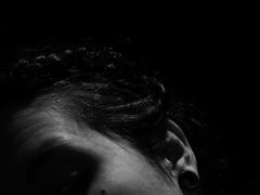 Todo el mundo sabe todo, pero nadie entiende nada. (mynikonismyfourtheye) Tags: bw bn grey reflections me myself hair shadow contrast old nikon coolpix l820 light face portrait poetry