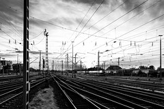 Wires and rails (Job I) Tags: dortmund hbf central station trains wires rails sunset sky dark city urban architecture landscape germany ruhrgebiet europe industrial industry black white bw