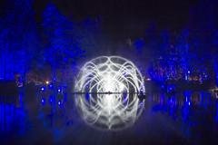 Enchanted (hazelhouliston) Tags: forest night enchantedforest lights scotland blue water reflection trees outdoors nature