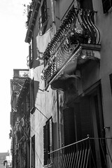 looking up, into the sun, balconies, Venice Italy, Nikon D40, Sigma 18-50mm EX DC MACRO, 11.6.16 (steve aimone) Tags: lookingup intothesun balconies architecture venice italy nikond40 sigma1850mmexdcmacro blackandwhite monochrome monochromatic venezia venetto