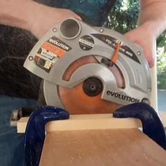 219/366 - DIY day (Spannarama) Tags: 366 august circularsaw saw cutting powertool sawdust spray workbench workmate clamps wood hands