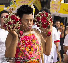 Flowers to you! Street procession. Phuket Vegetarian Festival. October, 2016. Phuket, Thailand (Andaman4fun) Tags: flower   street city town day annual men man face phuket vegetarian festival people tattoo piercing cut scarification blood thailand samui krabi pattaya bangkok lanta chang chinese famous              color red gold yellow island outdoor national tribe phuketian groupshot today show terrible costume portrait  crowd    phuketvegetarianfestival phuketfestival vegetarianfestival