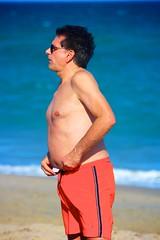 Man in Orange on Beach (LarryJay99 ) Tags: neck male man dude profile dudes atlanticocean sunglasses guys armpits guy barefootbarefeetglasses nipples hairylegs lakeworthbeach lakeworthbeachlakeworth bellybutton men arms legs face seashore navel belly canonef70300mmf456isusm