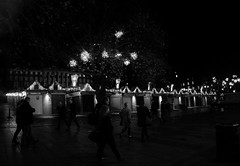 335/366 Late Night Shopping (denise.ferley) Tags: streetphotography street sonynex5 shopping shoppers norwich norwichmarket night city citylife bw blackandwhitephotography peoplewatching people pavement watching walking christmaslights fun england 3662016 366 oneaday