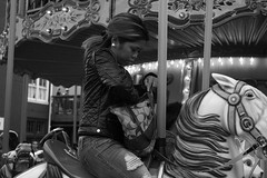 ups and downs (edwardpalmquist) Tags: fishermanswharf sanfrancisco california merrygoround city street urban blackandwhite monochrome people woman horse carousel