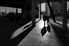 2 people - 3 shadows (heinzkren) Tags: shadow people street sun kontrast weitwinkel olympus panasonic lumix licht schatten reflection wien vienna paar couple hauptbahnhof gegenlicht sonnenuntergang campus erste outdoor