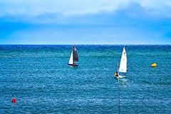 Wind and sails (Fnikos) Tags: sea seascape water wind sky skyline cloud boat sail people vehicle serene outdoor