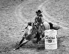 024693629-83-2016 NFR Cowgir Racing the Wind-2-Black and White (Jim There's things half in shadow and in light) Tags: 2016 canon5dmarkiv canon70200lens lasvegas nationalfinals nevada rodeo thomasandmack unlv action animal cowboy december sports cowgirl barrelracing horse speed blackandwhite