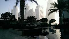 Dark Waters (BazzaStrae) Tags: dubai hotel pool sky scraper high rise buildings distance water swim desert sand