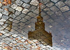 Reflected Palace of Culture and Science (john atte kiln) Tags: palaceofcultureandscience reflection cobbles puddle leaves fallenleaves wet autumn fall warsaw poland warszawa polska masovian tower clocktower ornate