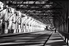 Falls Bridge (lucymagoo_images) Tags: sony rx100 philadelphia schuylkill river falls bridge bw monochrome vanishing point contrast street sidewalk cyclist shadows darkness light urban city patterns