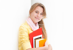 Young pretty female student on white background. (Konstantin Yolshin) Tags: school red portrait people orange woman white cute college girl beautiful beauty smile smart yellow modern lady female youth computer notebook happy book student education university pretty outdoor background joy young graduation lifestyle file study teen jacket scholar casual graduate cheerful joyful tablet folder learn hold clever academic teenage caucasian