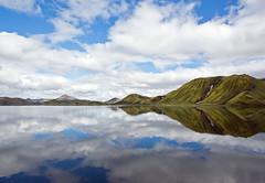 Reflections in a lake in Landmannalaugar, Iceland (Miche & Jon Rousell) Tags: blue panorama mountain lake reflection rock clouds iceland pano getty gettyimages landmannalaugar frameit rhyolitic betterthangood absolutelystunningscapes fjallabaknaturereserve