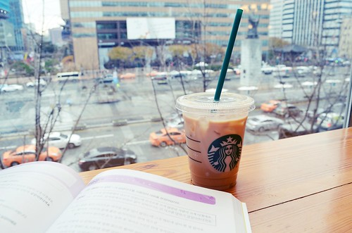 Iced Soy Latte and Korean grammar with Yi Sun-sin on a rainy afternoon at the Gwanghwamun Starbucks