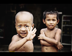 Lea Sen Hauy (Goodbye) Cambodia and Southeast Asia (Sam Antonio Photography) Tags: poverty travel shirtless portrait people sunlight tourism nature boys childhood smiling horizontal closeup standing fun outdoors photography asia cambodia southeastasia day sitting child friendship smiles happiness innocence males phnompenh goodbye cheerful siemreap waving success groupofpeople cultures playful greeting carefree battambang developingcountries ethnicity frontview indochina headandshoulders mekongriver toothysmile socialissues wavegoodbye realpeople humanface colorimage physicalactivity smallgroupofpeople lookingatcamera 45years cambodianchildren childrenonly indigenousculture focusonforeground battambangcambodia canoneos5dmarkii cambodianculture southeastasianethnicity asianandindianethnicities samantoniophotography cambodianethnicity