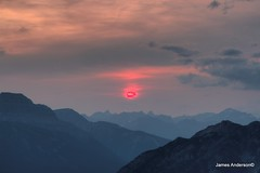 Pink Sun (JA Photography - Be There, Out There) Tags: sunset canada sunrise atmosphere alberta sulphurmountain banffnationalpark rayleigh jamesanderson rayleighscattering japhotography miescattering