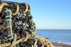 Lobster Pots on the Beach (A-Lister Photography) Tags: uk blue light sea england sun sunlight white holiday fish detail texture industry beach horizontal closeup rural work landscape sussex coast countryside seaside fishing workers focus holidays warm industrial waves colours bright westsussex tide tranquility sunny bluesky rope pot pots coastal lobster lowtide colourful copyspace seafront sunlit economic economy selsey tone tranquil lobsterpots tranquillity selectivefocus worklife differentialfocus adamlister nikond5100 alisterphotography