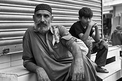 there & here.. (camelot98.) Tags: street leica travel pakistan boy portrait urban blackandwhite bw man 50mm asia candid streetphotography streetportrait rangefinder karachi summilux m9 {vision}:{people}=099 {vision}:{face}=099