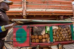 Cameroonian Beignet (Donal James Boyd) Tags: africa man beignet northwest market sweet dough pastry cart selling cameroon bamenda
